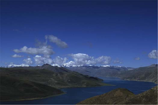 Yamdrog lake, from the Gampala pass. In the background is Nojin Gansang, the mountain god protecting the Yamdrog area